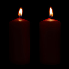 Two lighted candles isolated