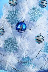 White Christmas tree on blue background