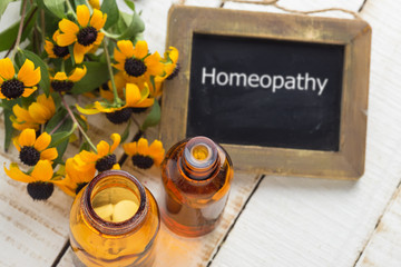 Herbs and bottle with medicines. Concept homeopathy.