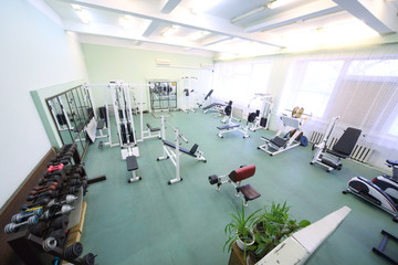 Top view on spacious empty gym with special equipment