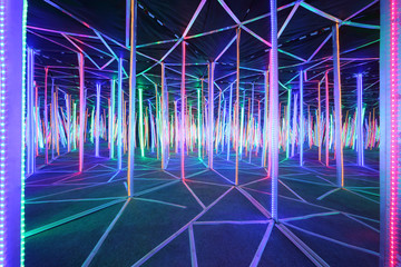 Mirror labyrinth lit with bright multicolored light