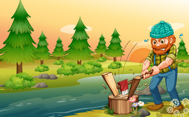 A man chopping woods at the riverbank