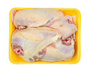 Large chicken breasts on a yellow foam tray