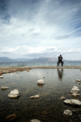 Man sitting on chair admires the view on the seaside