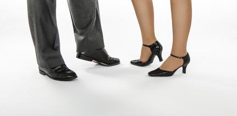 Male and female feet in ballroom