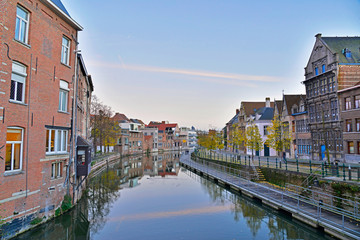Old houses with canal of Mechelen at sunset. Belgium.