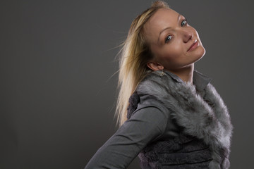 Fashion Blond Real Model Female Posing with Fur in Luxury Style