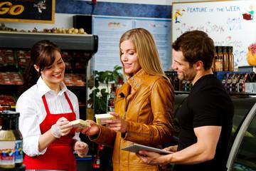 Couple shopping in butcher shop