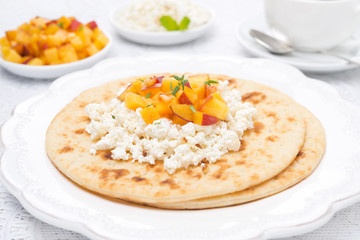 Flat bread with cottage cheese with honey, nuts, fresh peaches