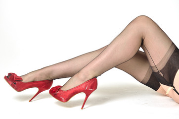 Red shoes black stockings
