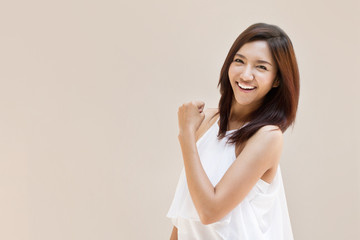 happy, positive, smiling, confident woman on plain background