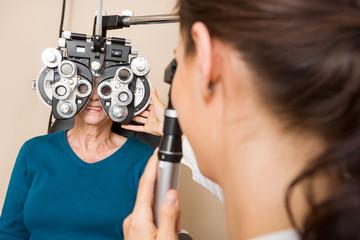 Optometrist Examining Patient's Vision