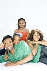 Happy family spending time together on white background