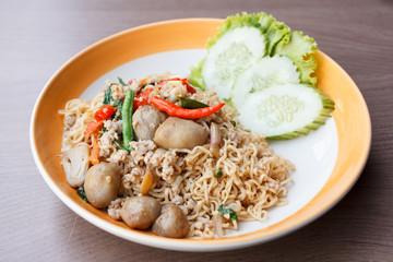 stir fried  spicy  noodle with pork and straw mushroom