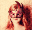 little girl  in carnival mask