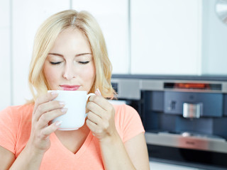 Beautiful woman enjoys a cup of Coffee