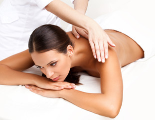 Wall Mural - Massage. Close-up of a Beautiful Woman Getting Spa Treatment