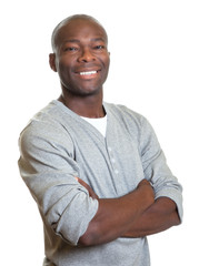 Attractive african man with crossed arms laughing at camera