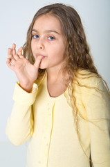 Girl licks his fingers after eating