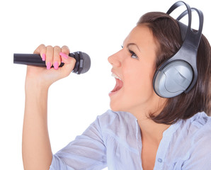 Caucasian female singing in to microphone.