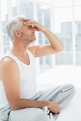 Side view of a thoughtful mature man in bed