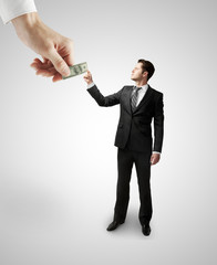 hand giving dollars