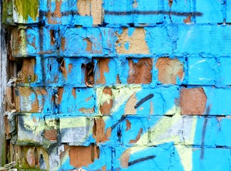Old brick wall with colorful graffiti