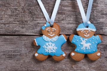 Two blue gingerbread men. Girl with bow and the boy in a hat