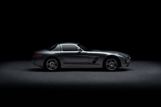 Side view of luxury sports car over black background
