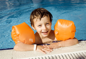little cute boy in swimming pool