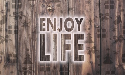 wooden enjoy life symbol with presents