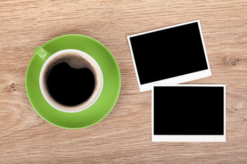 Cup of coffee and two photo frames