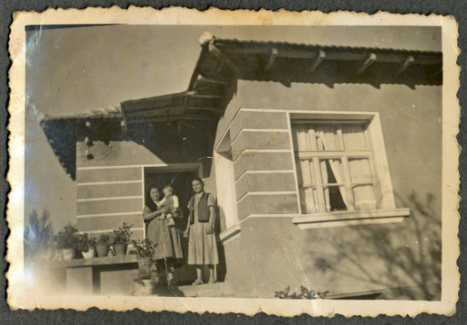 CIRCA 1955: Two women on the porch of the house
