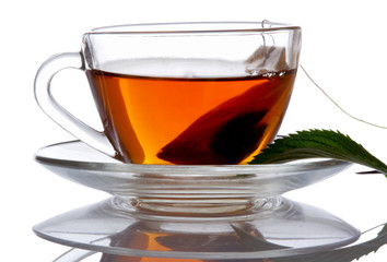 Cup of tea and mint, isolated on white background
