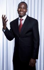 African American businessman standing in office.