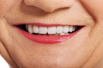 Close up on ol woman's smile, teeth.