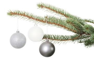 Three christmas balls hanging on christmas tree.