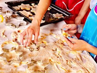 Female hand kneading dough.