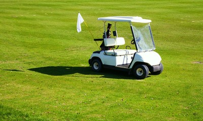 Golf-cart car on golf course green