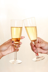 Man and Woman toasting with Champagne glasses