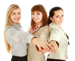 businesswomen putting their hands, isolated on white background