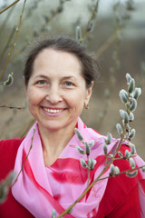 woman in spring pussywillow plant