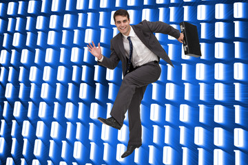 Composite image of smiling businessman in a hury
