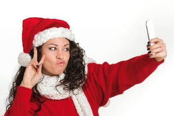 Attractive brunette santa girl taking self portrait
