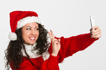 Attractive brunette santa girl taking self portrait