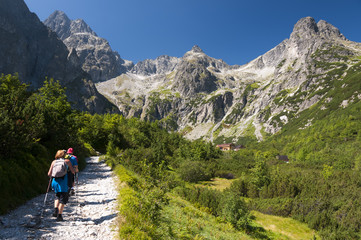 Tourists at chalet at Zelené pleso, High Tatras, Slovakia