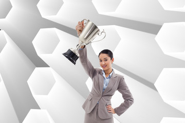 Composite image of businesswoman showing a cup