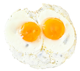 top view of two fry eggs on white