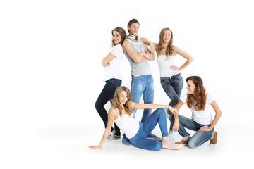 Obraz Ekipa młodych ludzi na białym tle - fototapety do salonu