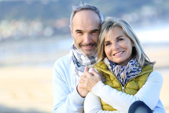 Senior couple sitting by the beach